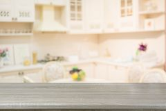 Blurred background. Empty wooden tabletop and defocused modern kitchen. Royalty Free Stock Images