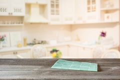 Blurred background. Empty wooden tabletop and defocused modern kitchen. Royalty Free Stock Photos