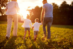 Blurred background of family in nature Royalty Free Stock Photos