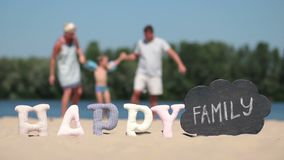 Blurred background of family playing on the beach stock video footage