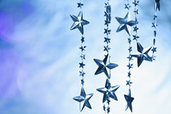 Blurred background with garland of stars. Royalty Free Stock Photos