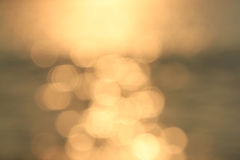 Blurred Background with golden lens flares Stock Photo