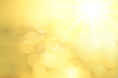 Blurred Background with golden lens flares an sun Royalty Free Stock Images