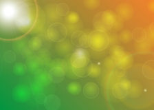 Blurred Background Green Yellow Orange Bokeh. With SUnrays Stock Images