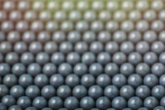 Blurred background of grey airsoft balls of 6mm.  Stock Images