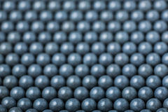 Blurred background of grey airsoft balls of 6mm Royalty Free Stock Photo