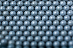 Blurred background of grey airsoft balls of 6mm.  Royalty Free Stock Photography