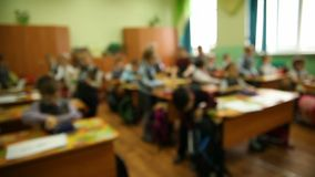 Blurred background group of kids in a classroom at stock video