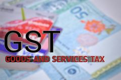 Blurred background with GST text. Stock Photo