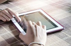 blurred background hands using modern tablet device, young hipst Stock Photo