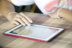 blurred background hands using modern tablet device, young hipst Stock Images