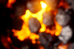 Blurred background of hot glowing coals Royalty Free Stock Images