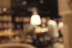 Blurred background image of coffee shop blur group of people. stock image