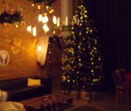 Blurred background. Living room with a Christmas tree. Decorated with garlands stock photos