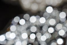 Blurred background. Lots of glowing white spots of heptagons. Ab. Stract background Stock Photography