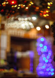 Blurred background made with Christmas tree and fireplace Stock Photo