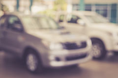 Blurred background : new car parking in showroom Stock Photos