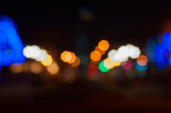 Blurred Background night street with bright illumination. A large bright bokeh Stock Photo