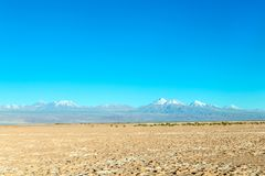Free Blurred Background Of Atacama Desert Landscape With Snow-capped Andean Volcanos, Salt Flat And Some Vegetation On Horizon, Chile Stock Photo - 150312980