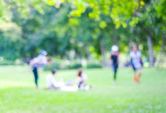 Blurred background of people activities in park with bokeh light Stock Image