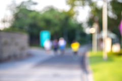 Blurred background of people activities in park with bokeh. Spring and summer season Royalty Free Stock Photo