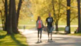 Blurred background of people activities in park with bokeh, spring and summer season stock footage