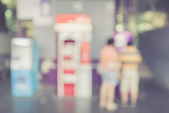 Blurred background : People stand infront of ATM machine Royalty Free Stock Image