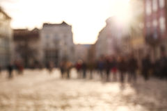 Blurred background people in town square of old city at sunset Royalty Free Stock Images