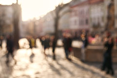 Blurred background people in town square of old city at sunset Royalty Free Stock Photo