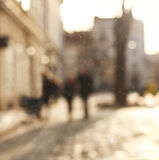 Blurred background people in town square of old city at sunset Royalty Free Stock Image