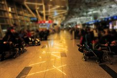 Blurred background of people waiting in Airport. Half Blurred background of people waiting in Airport Royalty Free Stock Photography