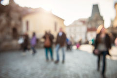 Blurred background of people walk on the pavement in city Stock Images