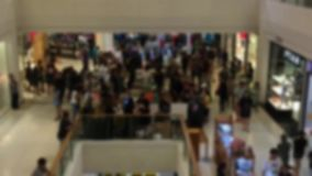 blurred background of people walking and shopping inside the mall stock footage