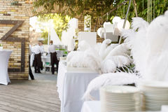 Blurred background, professional waiters on duty. Outdoor party with finger food. Catering service. stock image