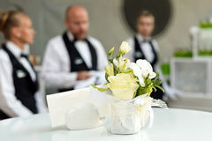 Blurred background, professional waiters standing in a row. Outdoor party with finger food. Catering service. stock image