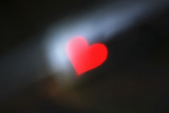 Blurred background with red heart Stock Photography