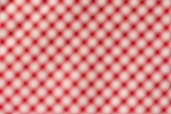 Out of focus background. Red plaid pattern. Blurred background. Red and white plaid pattern. Full frame of checked backdrop Stock Images