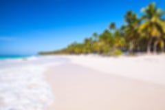 Blurred background, sandy beach. Blurred photo background with white tropical sandy beach. Caribbean Sea coast, Dominican republic, Saona island Stock Photography