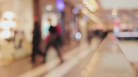 Blurred background shopping mall. People pass by, shoping