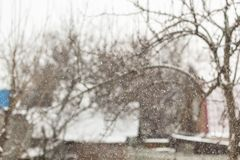 blurred background snow winter village small houses and trees royalty free stock image