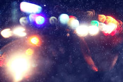 Blurred background  snowfall with night lights Stock Image