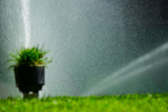 Blurred background with soccer or football field irrigation system of automatic watering grass Royalty Free Stock Photo