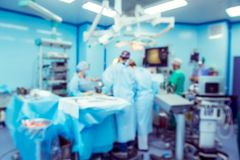 Blurred background with team surgeon at work with laparoscopic equipment in operating room. Blurred background with team surgeon at work with laparoscopic Stock Photo