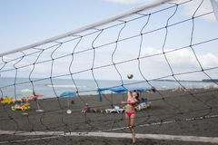 Blurred background. Teenage Friends Playing Volleyball On Beach royalty free stock images