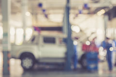 Blurred background : Thai people repairing the car in garage Royalty Free Stock Images