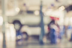 Blurred background : Thai people repairing the car in garage Stock Photography