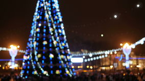 Blurred Background town square before the new year. Evening festivities urban residents around the Christmas tree.  stock footage