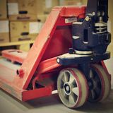 Blurred background warehouse. Abstract blurry warehouse storing. Pallet truck. Royalty Free Stock Image