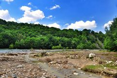 Blurred banks of a mountain river Royalty Free Stock Image