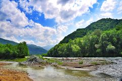 Blurred banks of a mountain river Stock Photography